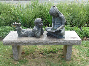 Statue of kids on a bench
