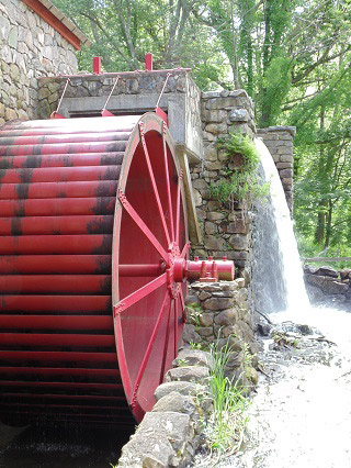 A water wheel on a mill.